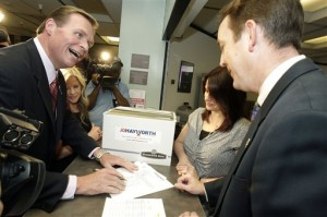 Former Arizona Republican Rep. J.D. Hayworth, left, talks with Arizona Secretary of State Ken Bennett, right, as he hands over the necessary signatures to get his name on the Aug. 24 primary election ballot to challenge incumbent Sen. John McCain, Monday, April, 26, 2010, in Phoenix.  Second from left is Mary Hayworth, J.D. Hayworth's wife, and second from the right is Amy Bjelland, State Election Services Director. (AP Photo/Ross D. Franklin)