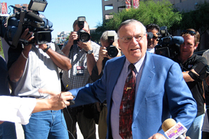 Maricopa County Sheriff Joe Arpaio is swarmed by media seeking comment on a federal lawsuit filed against him after a news conference at which he and other conservatives said they are sending Major League Baseball 70,000 petition signatures against any plan to relocate the 2011 All-Star Game. MLB officials haven't said anything to indicate they might move the game from Phoenix over SB 1070, but Arpaio and other said they worry that officials might heed the calls of a critics and activists. (Cronkite News Service by Maria Polletta)