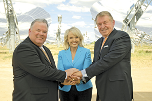 (From left) Arizona Commerce Authority President and CEO Don Cardon, Gov. Jan Brewer and developer/sports entrepreneur Jerry Colangelo pose for a photo at Stirling Energy Systems/Tessera Maricopa Solar Field. The group serves with 33 others as the newly formed Arizona Commerce Authority Board, which is charged with making recommendations on improving the state's economy.