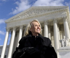 Arizona Gov. Jan Brewer stands outside the Supreme Court in Washington, Wednesday, Dec. 8, 2010, after attending arguments at the Supreme Court who will decide if the Arizona employer sanctions law is constitutional.  (AP Photo/Susan Walsh)
