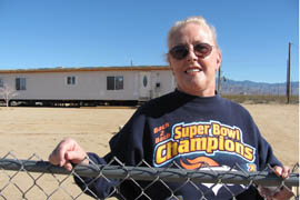Roberta Birdsell outside her mobile home on land she purchased in the northwestern Arizona community of Golden Valley. Her local utility wanted $7,500 to extend a power line 350 feet to her property. (Cronkite News Service Photo by Griselda Nevarez)