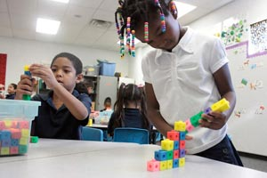 Dezi Meadows, left, and Christina Wright work with building blocks in Barnhizer's kindergarten class. Barnhizer began the year with more than 30 students in her classroom. (Cronkite News Service photo by Nick Kosmider)