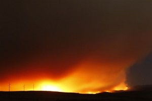 The Wallow fire burns towards Eagar, Ariz,  north of Greer, Ariz,,  Wednesday night June 8, 2011. The fire in eastern Arizona that already forced thousands from their homes headed Wednesday for a pair of transmission lines that supply electricity to hundreds of thousands of people as far east as Texas.   (AP Photo/Rob Schumacher/The Arizona Republic)