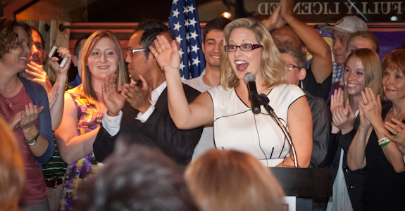 Former Arizona Senator Kyrsten Sinema acknowledges supporters and campaign staff during her Democratic primary victory speech. (Photo by Evan Wyloge/Arizona Capitol Times)