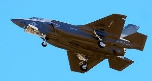 In this Friday, Nov. 16, 2012, file photo, the first F-35B fighter jet attached to Marine Fighter Attack Squadron 121 arrives at Marine Corps Air Station Yuma in Yuma, Ariz. So far two veteran pilots of the 3rd Marine Aircraft Wing have been trained to fly the F-35B. They are becoming the first members of the Marine Fighter Attack Squadron 121 that will debut at a ceremony Tuesday, Nov. 20, at the Marine Corps Air Station in Yuma, Ariz.(AP Photo/The Yuma Sun, Craig Fry, File)