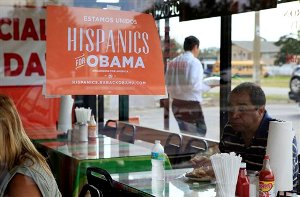 In this Oct. 26, 2012, file photo, Spanish language election campaign signs promoting President Barack Obama hang on the windows at Lechonera El Barrio Restaurant in Orlando, Fla. Hispanics supported President Barack Obama over Republican Mitt Romney by almost 3-to-1 and put Republicans on notice they must take real steps to win over the nation's largest minority group if they want to win the presidency again. Exit polls say that Romney, who has backed hardline immigration measures, won only 27 percent of Hispanics. (AP Photo/Julie Fletcher)