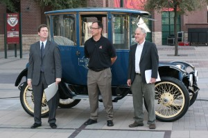 From left, Phoenix Mayor Greg Stanton, Luis Gonzalez of the Arizona Diamondbacks and Will Toor, director of transportation programs for the Southwest Energy Efficiency Project, stand in front of a 1915 electric vehicle belonging to APS. (Cronkite News Service Photo by Cuyler Meade)
