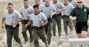 In this April 5, 2007 file photo, a group of new Border Patrol agents run with their instructor at the Border Patrol Academy in Artesia, N.M. A Sept. 17, 2013 report says a surge in Border Patrol agents hasn't impaired their use-of-force training but that the Department of Homeland Security needs to better track excessive force allegations. (AP Photo/Matt York, File)