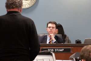 Arizona Corporation Commission Chairman Bob Stump listens during comments from the public on the proposal to change the state's solar net metering system. (Photo by Evan Wyloge/Arizona Capitol Times)