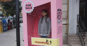 """Groups fighting sex trafficking tried to raise awareness of the abuse of minors by traffickers in November, putting a teen girl inside a life-sized doll box labeled """"for sale"""" on a street in downtown Washington. (Cronkite News Service photo by Pei Li)"""