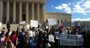 "Protesters outside the Supreme Court in 2012 rally against the court's decision in Citizens United, one of two rulings that has helped boost the influence of so-called ""dark money"" groups in elections. (Photo by Jordan Krueger via flickr/Creative Commons)"