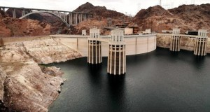 FILE - In this April 16, 2013 file photo, the high water mark for Lake Mead is seen on Hoover Dam and its spillway near Boulder City, Nev.Fearing ongoing drought and dwindling water supplies, Western states are struggling to capture every last drop with projects like dams and diversions that some think could threaten the cooperation that experts say is crucial to managing the scarce resource. Against the backdrop of what could be a looming turf war, eight Western governors meeting in Las Vegas will talk this weekend about drought, and water managers from seven states will meet a couple of days later to talk about ways to make sure 40 million customers in the parched Colorado River basin don't go thirsty. (AP Photo/Julie Jacobson, File)