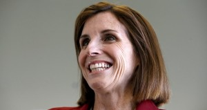 Republican Martha McSally smiles as she talks to the media at her campaign headquarters Dec. 17, 2014, in Tucson. (AP Photo/Ross D. Franklin)