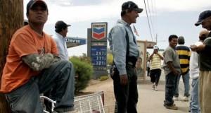 Day laborers seek work in Phoenix. (The Associated Press)