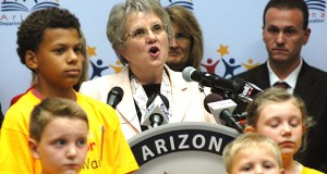 Surrounded by her staffers and their children, state schools chief Diane Douglas details her multi-point plan to improve education in Arizona. (Capitol Media Services photo by Howard Fischer)