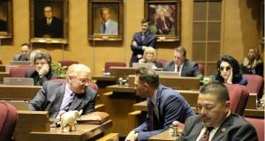 Sens. Bob Worsley, R-Mesa, and Steve Smith, R-Maricopa, chat during budget debate in the Senate May 3. (Photo by Gary Grado/Arizona Capitol Times)