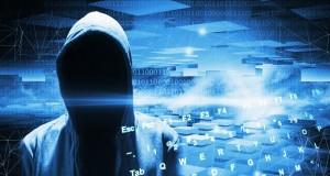 Hacker in a hood on dark blue digital background