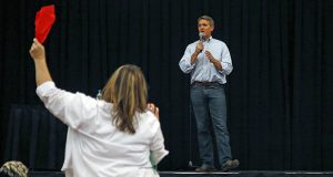 Arizona Republican Sen. Jeff Flake tries to answer a question during a town hall Thursday, April 13, 2017, in Mesa, Ariz. Flake is holding his first public event with constituents since January after coming under withering criticism for his voting record and avoiding such gatherings in recent months. (AP Photo/Ross D. Franklin)