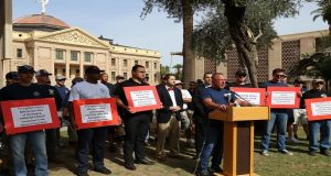 Bryan Jeffries, president of the Professional Fire Fighters of Arizona, speaks at a rally of firefighters who have suffered from cancer or heart-related illness on April 25. The group gathered at the Capitol in support of two bills that would increase workers' compensation for firefighters who contract diseases in the line of duty. (Photo by Katie Campbell, Arizona Capitol Times)