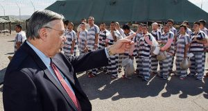In this February 4, 2009, file photo, Maricopa County Sheriff Joe Arpaio orders approximately 200 convicted illegal immigrants handcuffed together and moved into a separate area of Tent City for incarceration until their sentences are served and they are deported to their home countries. (AP Photo/Ross D. Franklin)