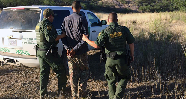 Border Patrol agents arrest an alleged border-crosser in June near a medical aid camp in the desert near Arivaca. While such cases are typically dispensed with quickly, new numbers show the backlog for other pending immigration cases has reached record levels, and sparked record delays. (Photo courtesy Customs and Border Protection)