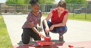 Volunteers along with students in the Roosevelt School District work together with United Way on school beautification projects such as playground repainting, creating U.S. maps on the playground and school murals.
