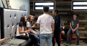 Apache County youth explore the new community center in St. Johns, dubbed The LOFT to capitalize on the trendy, industrial styling. The space once housed the county's juvenile detention center. (Photo courtesy of Amy Love/Arizona Supreme Court)
