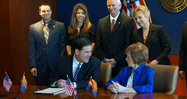 Gov. Doug Ducey chats with former Gov. Jane Hull March 26, 2018, as Ducey signs an extension of Proposition 301, a sales tax dedicated to funding education in the state. Hull was the governor when voters gave their approval of the tax in 2000. Behind them from left are House Speaker J.D. Mesnard, House Minority Leader Rebecca Rios, Rep. Doug Coleman, R-Apache Junction, Sen. Kate Brophy-McGee, R-Phoenix. (Photo courtesy of the Governor's Office)