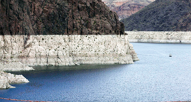 "In this April 16, 2013, file photo, a ""bathtub ring"" shows the high water mark on Lake Mead near Boulder City, Nev. Tension among U.S. states that rely on the Colorado River escalated into a public feud when an Arizona water provider was accused of manipulating the level of Lake Mead amid a prolonged drought, threatening supplies for 40 million people in two countries. (AP Photo/Julie Jacobson, File)"