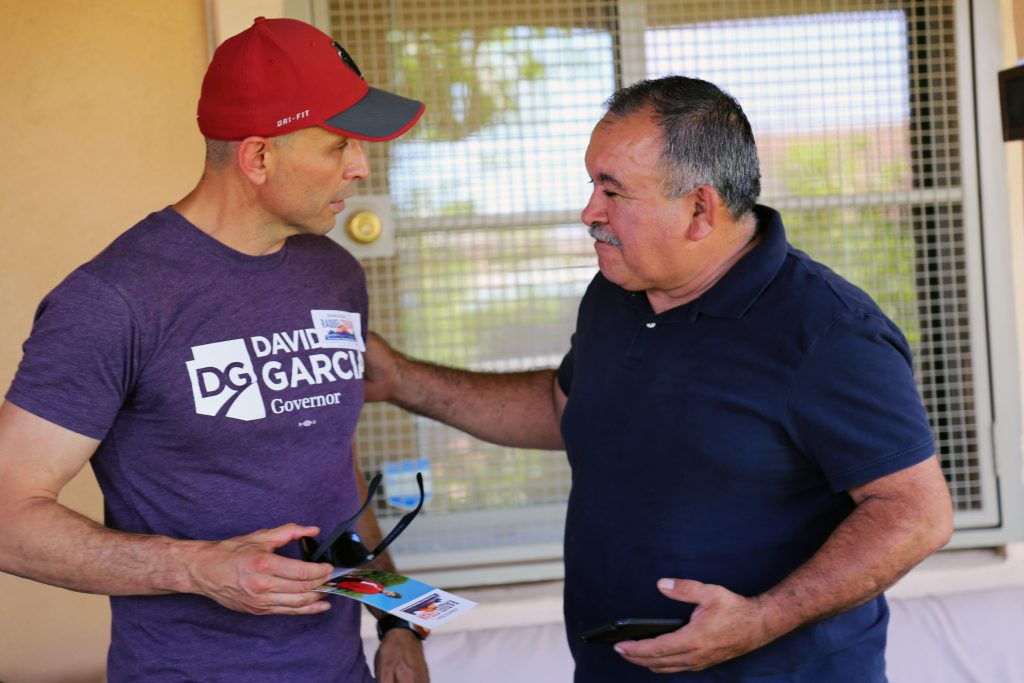 Democratic candidate for governor David Garcia speaks with a voter June 10 as he canvassed a west Phoenix neighborhood. (Photo by Carmen Forman/Arizona Capitol Times)