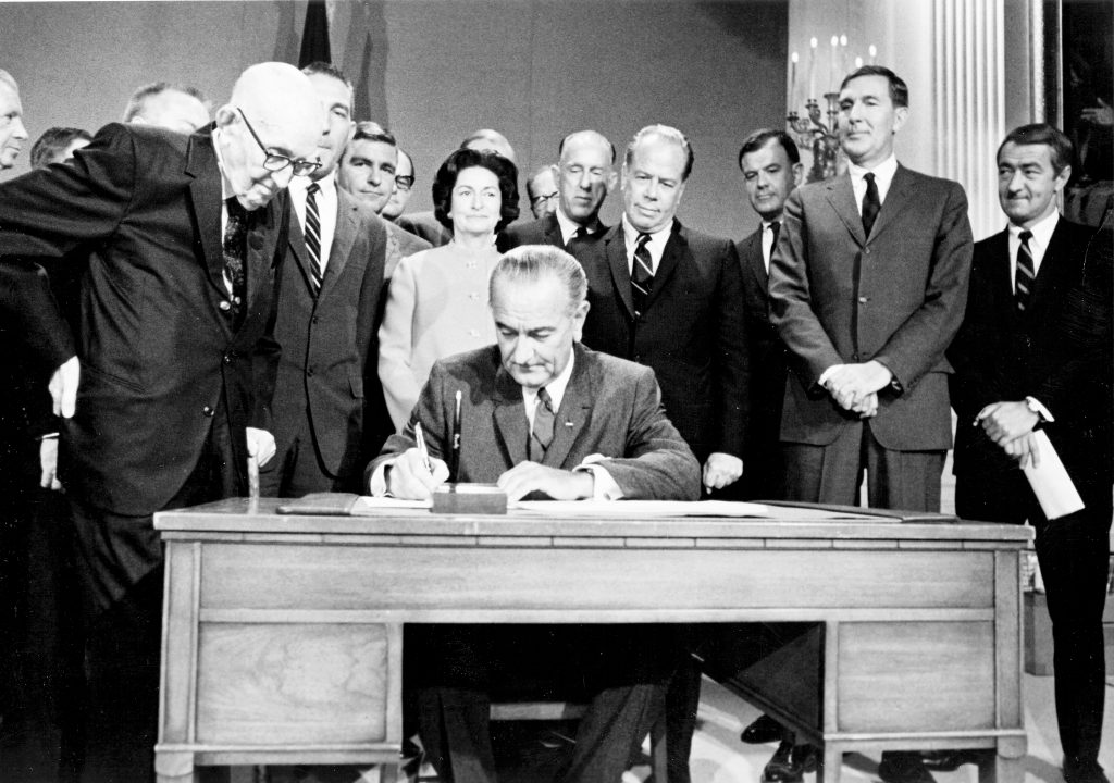 In this Sept. 30, 1968 photo, President Lyndon Johnson signs legislation that creates the Central Arizona Project. With the president from left are Carl Hayden, John Rhodes, Lady Bird Johnson, Stewart and Mo Udall and Roy Elson. PHOTO COURTESY ARIZONA STATE UNIVERSITY LIBRARY