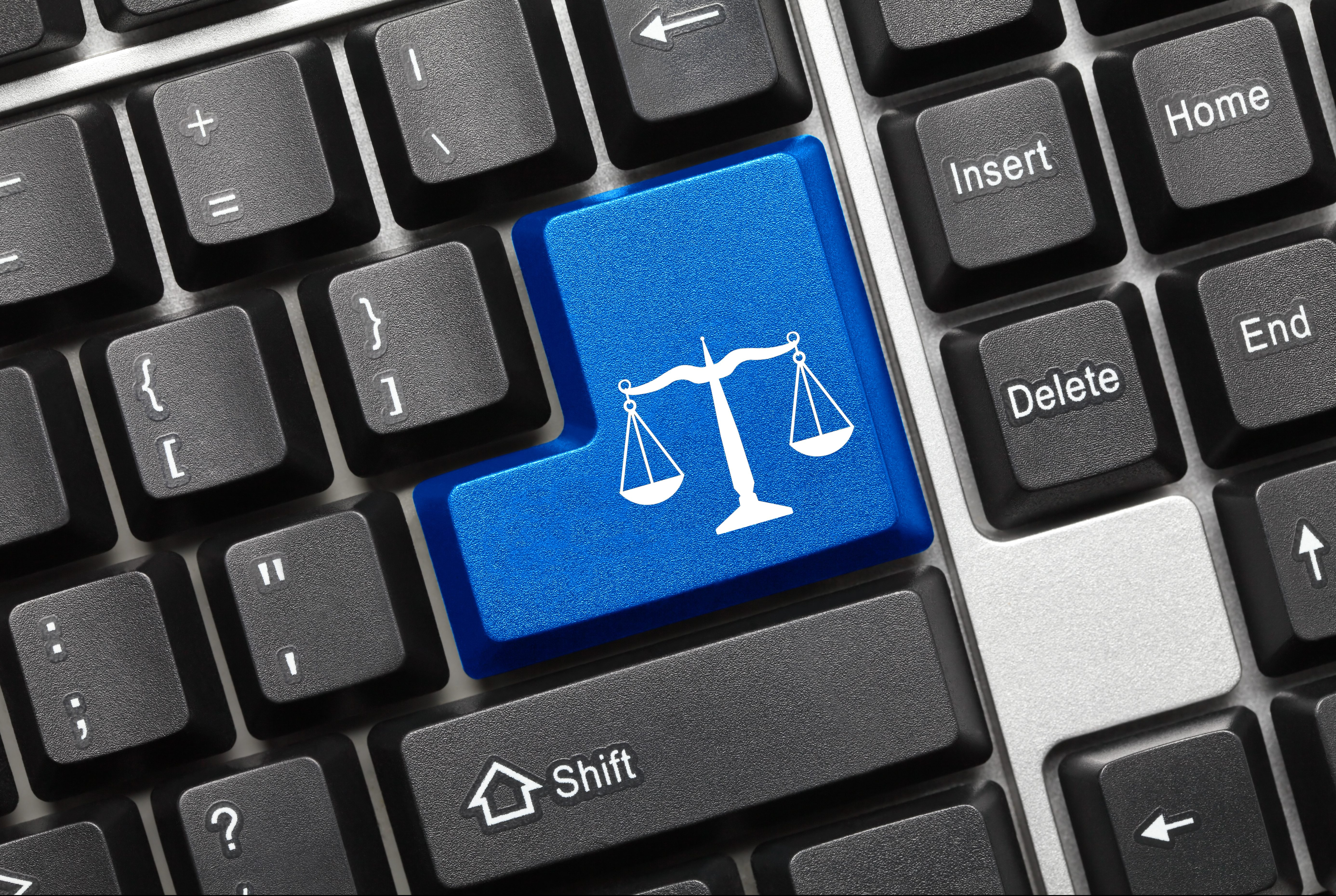 Close up view on conceptual keyboard - Law symbol (blue key)