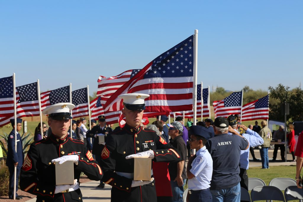 Two U.S. Marines carry urns containing the remains of veterans Oct. 26 at a ceremony at the Arizona Veterans' Memorial Cemetery in Marana. The Arizona Department of Veterans' Services and The Southern Arizona Missing in America Project joined to honor 37 unclaimed and indigent veterans. PHOTO BY JULIA SHUMWAY/ARIZONA CAPITOL TIMES