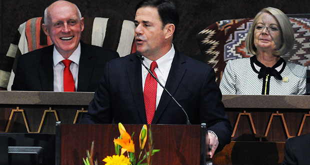 Gov. Doug Ducey addresses the Legislature on Monday, with House Speaker Rusty Bowers and Senate President Karen Bowers in the background. (Capitol Media Services photo by Howard Fischer)