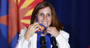 "Sen. Martha McSally, R-Ariz., smiles as she removes her face covering to speak prior to Vice President Mike Pence arriving to speak at the ""Latter-Day Saints for Trump"" coalition launch event Tuesday, Aug. 11, 2020, in Mesa, Ariz. (AP Photo/Ross D. Franklin)"