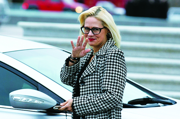 Sen. Kyrsten Sinema, D-Ariz., waves as she departs after the impeachment acquittal of President Donald Trump, on Capitol Hill, Wednesday, Feb. 5, 2020 in Washington. (AP Photo/Jose Luis Magana)