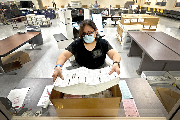 Arizona elections officials continue to count ballots inside the Maricopa County Recorder's Office, Friday, Nov. 6, 2020, in Phoenix. (AP Photo/Matt York)